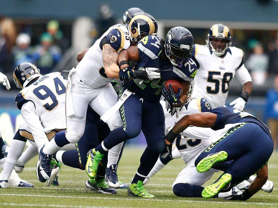 Seattle's Marshawn Lynch had been letting his game speak for itself this season, but with encouragement from the NFL, the former Cal standout is talking to the media again. Photo: Jonathan Ferrey, Getty Images