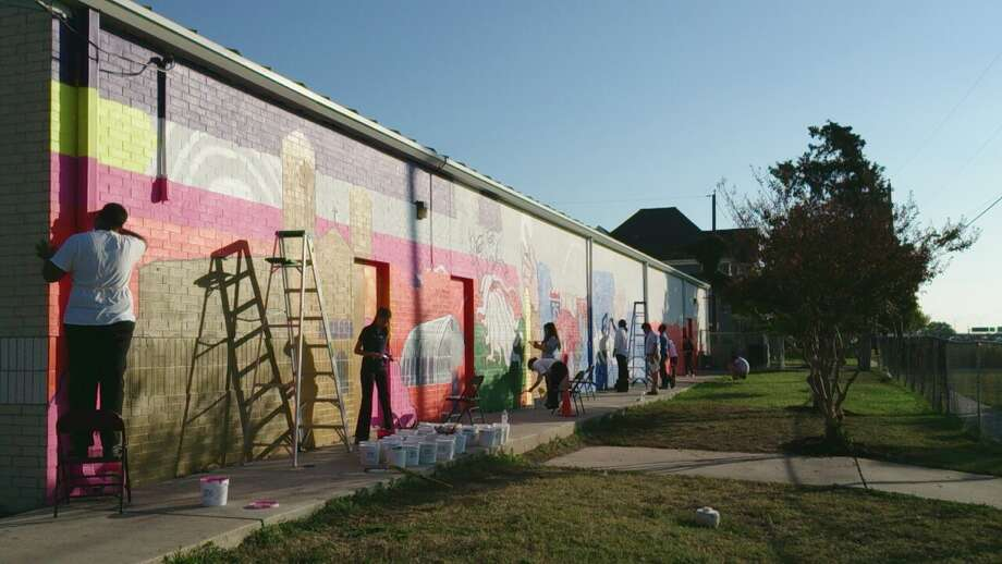 Students work on a mural with San Anto Cultural Arts. Photo: Courtesy San Anto Cultural Arts