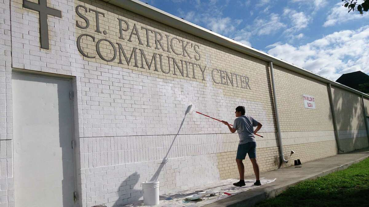 Students work on a mural with San Anto Cultural Arts.
