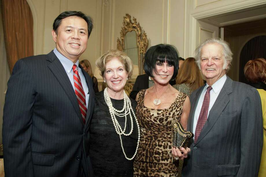 Darrrel Woo, Celeste Woo, Marilyn Caback and Michael Caback at the 2014 San Francisco Ballet Gala Benefactors pre-party on January 8, 2014. Photo: Drew Altizer Photography