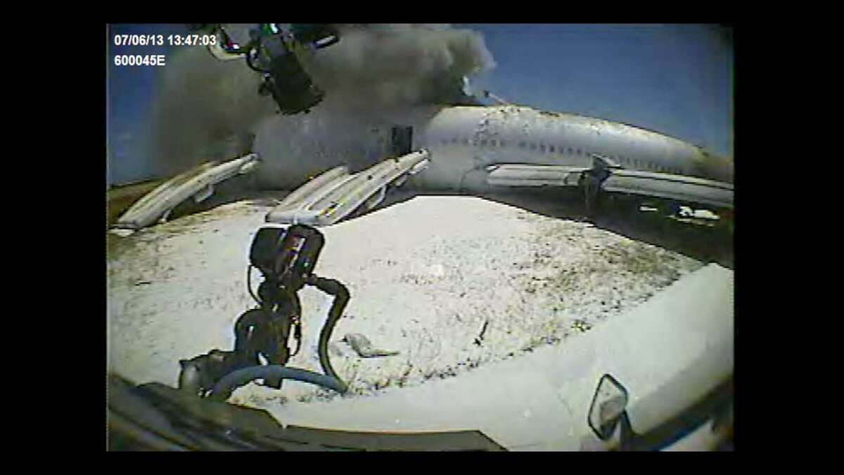A dashboard camera aboard a San Francisco Fire Department rig driven by firefighter Jimmy Yee, shot this image as the rig approached Asiana Airlines crash victim Ye Meng Yuan, in the foreground and partially obscured by foam. The rig ran over Ye seconds later.