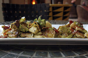 The Brussels sprouts served at Las Ramblas get their tempting flavor from apples, bacon and fennel pollen, a fragrant golden powder that is harvested from dried fennel blossoms.