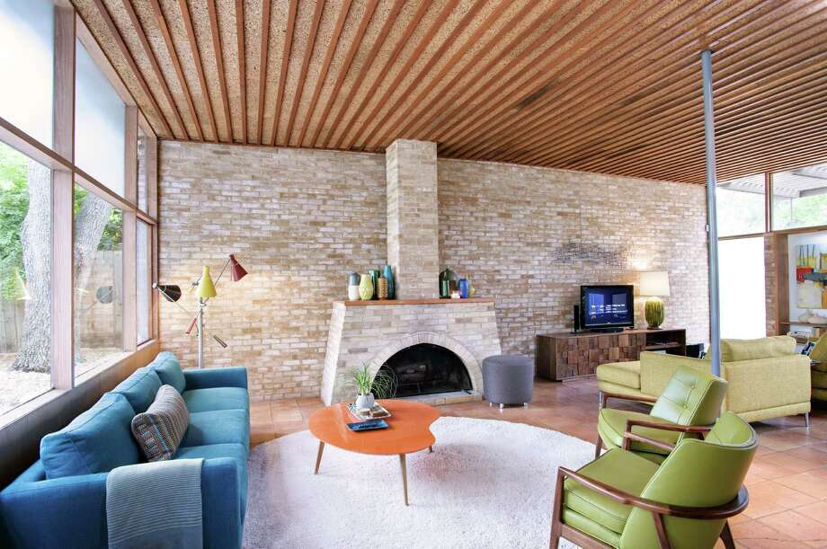 The living areas of the midcentury modern home are open and light. Cork ceilings and a fireplace made from local brick contribute to its handcrafted aura. Photo: Photos Courtesy Al Argueta / Apa Publications