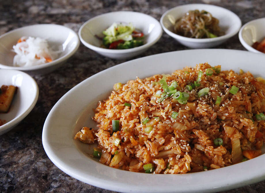 Kimchee fried rice, among the highlights at Koreana, is served with a variety of small dishes called banchan. Photo: Photos By Cynthia Esparza / For The San Antonio Express-News / For San Antonio Express-News