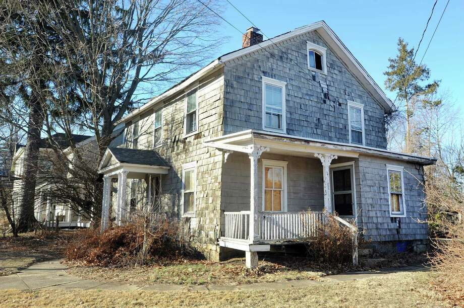 An abandoned house on Catoonah Street in Ridgefield, Conn. was mentioned at a hearing on the townâÄôs anti-blight laws held Wednesday, Jan. 8, 2014. Photo: Cathy Zuraw / The News-Times