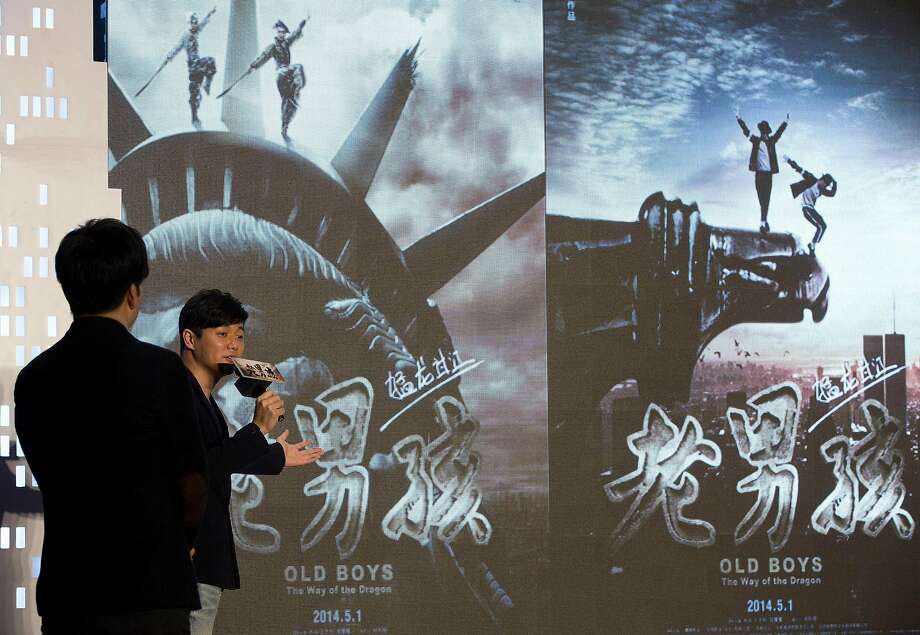 "Director and actor Xiao Yang (right) and Wang Taili promote their new movie, ""Old Boys: The Way of the Dragon,"" a full-length feature based on their popular, 43-minute microfilm. Photo: Andy Wong, Associated Press"