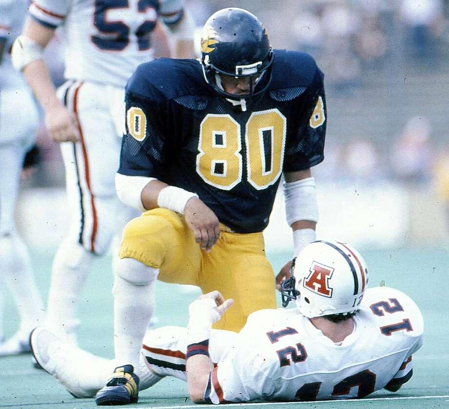 Ron Rivera, an All-America linebacker at Cal, sacks Arizona's Tom Tunnicliffe. Teammates considered Rivera serious and inquisitive. Photo: Cal Athletics