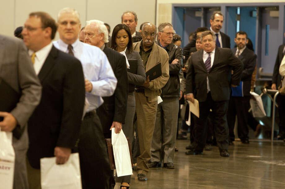 Applicants wait in line for the Chron Mega Job Fair at Reliant Center, Wednesday, Jan. 30, 2013, in Houston. (Cody Duty / Houston Chronicle) Photo: Cody Duty, Staff / © 2013 Houston Chronicle