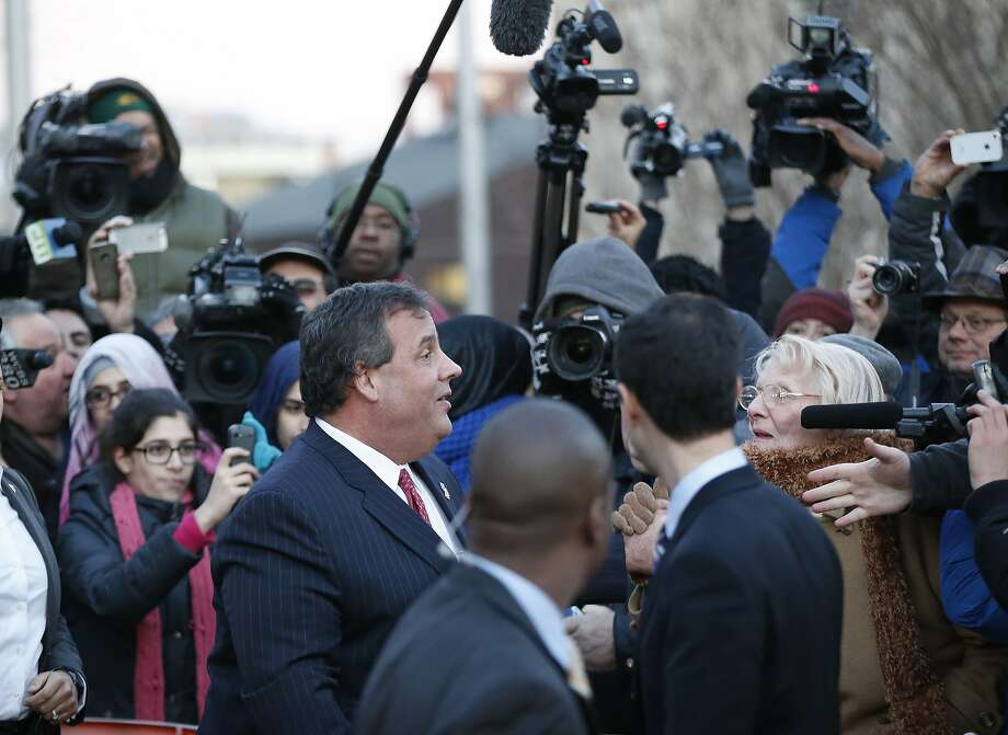 Gov. Chris Christie leaves Fort Lee, N.J., City Hall Thursday. Photo: Kathy Willens, Associated Press