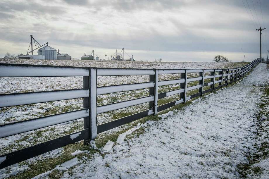 Until recently, periodic scenes like this of snow covering a fence in Danville, Ky., weren't all that uncommon. The global warming associated with climate change has made such situations much more rare. Photo: Clay Jackson / Associated Press / The Advocate Messenger