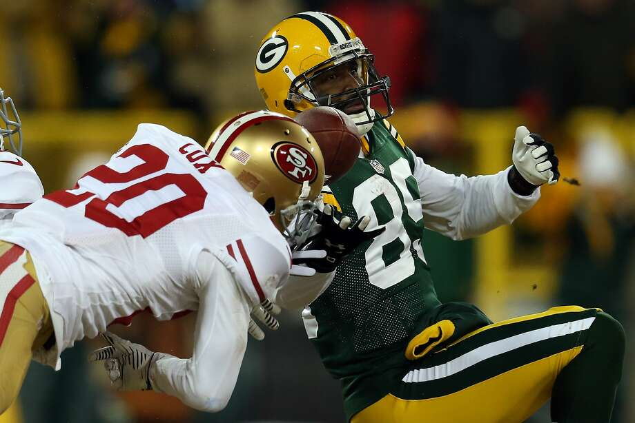 GREEN BAY, WI - JANUARY 05:   Perrish Cox #20 of the San Francisco 49ers breaks up a pass intended for  James Jones #89 of the Green Bay Packers thrown by  Aaron Rodgers #12 during their NFC Wild Card Playoff game at Lambeau Field on January 5, 2014 in Green Bay, Wisconsin.  (Photo by Jonathan Daniel/Getty Images) Photo: Jonathan Daniel, Getty Images