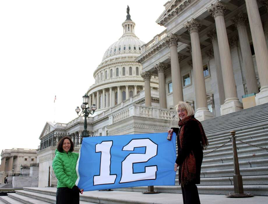 Washington's U.S. Senators Maria Cantwell, left, and Patty Murray hold up a 12th Man flag Wednesday, Jan. 8, on the steps of the U.S. Capitol Building in Washington, D.C. Photo: Alexa Seidl/Murray Staff