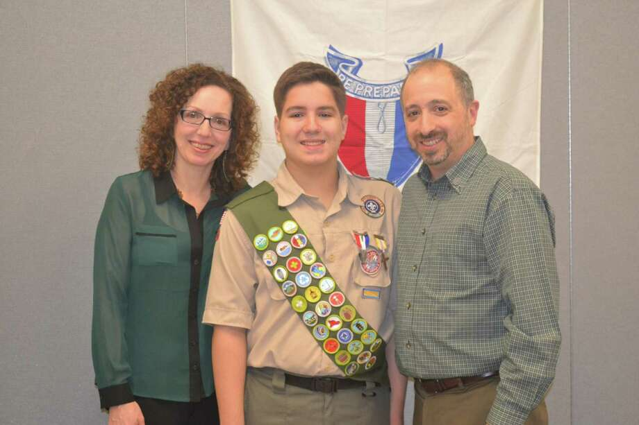 Noah J. Poust, a member of Boy Scout Troop 71 in Delmar, became an Eagle Scout in a ceremony at St. Thomas the Apostle School on Jan. 4. Poust, 17, is a Bethlehem High School junior and St. Thomas the Apostle School graduate. For his project, he renovated a playroom and conducted a book drive for the Farano Center for Children, a program of Catholic Charities of Albany?s Community Maternity Services. He stands here with parents Mary and Dennis. (Submitted photo)
