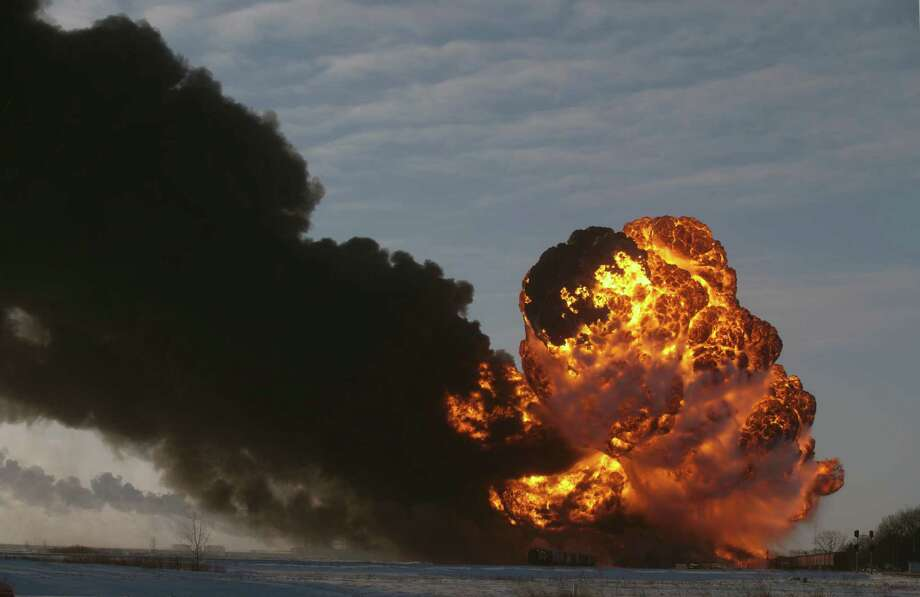 A fireball goes up at the site of an oil train derailment Monday, Dec 30, 2013, in Casselton, N.D. The train carrying crude oil derailed near Casselton Monday afternoon. Several explosions were reported as some cars on the mile-long train caught fire. (AP Photo/Bruce Crummy) ORG XMIT: NDBC102 Photo: Bruce Crummy / FR6524 AP