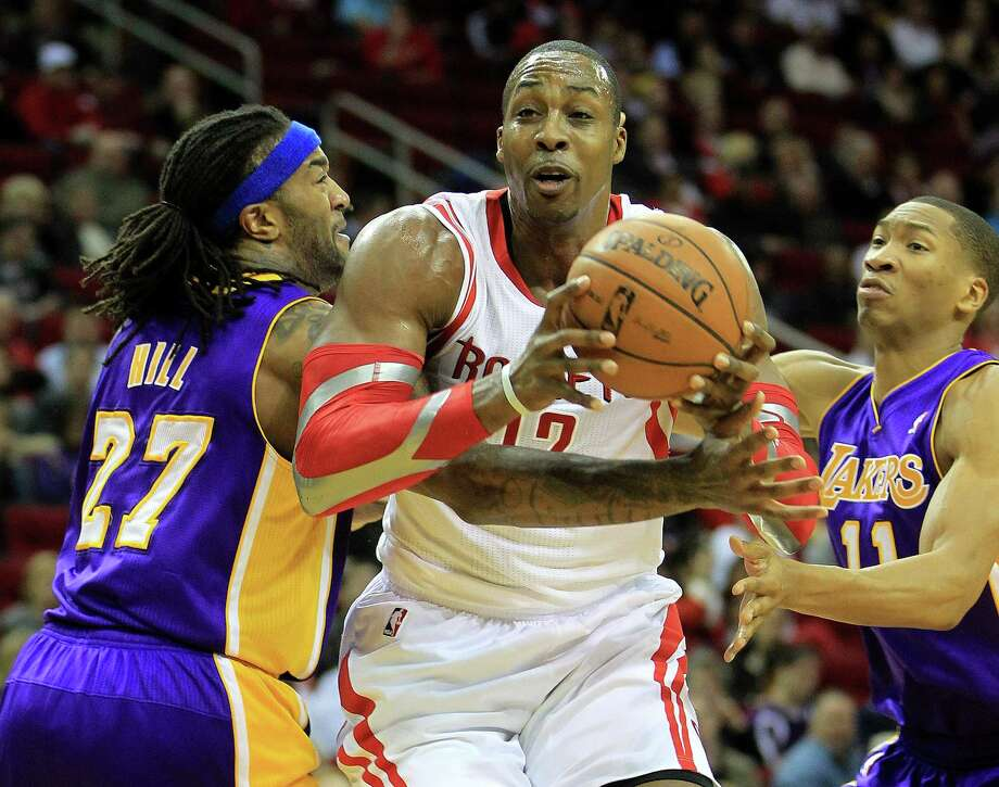 Even though the Rockets have finished strong to win their last two games, center Dwight Howard (12) says the team knows it needs to play better at the start of games, especially with a four-game road trip starting today. Photo: Karen Warren, Staff / © 2013 Houston Chronicle
