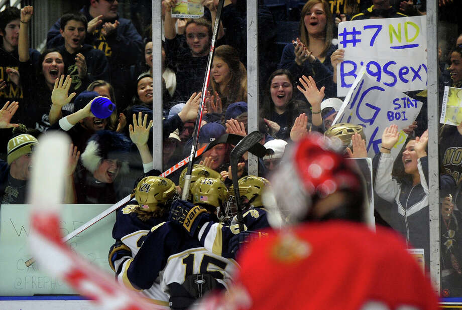 Notre Dame of Fairfield celebrates a goal over Fairfield Prep, during boys hockey action at the Webster Bank Arena in Bridgeport, Conn. on Thursday January 9, 2014. Photo: Christian Abraham / Connecticut Post