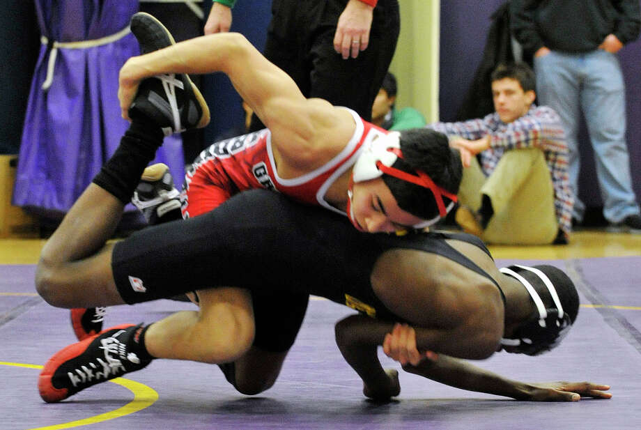 Greenwich's Brandon Aguda wrestles Westhill's Denver Dorsainvil in the 106-pound weight class during their wrestling match at Westhill High School in Stamford, Conn., on Thursday, Jan. 9, 2013. Photo: Jason Rearick / Stamford Advocate