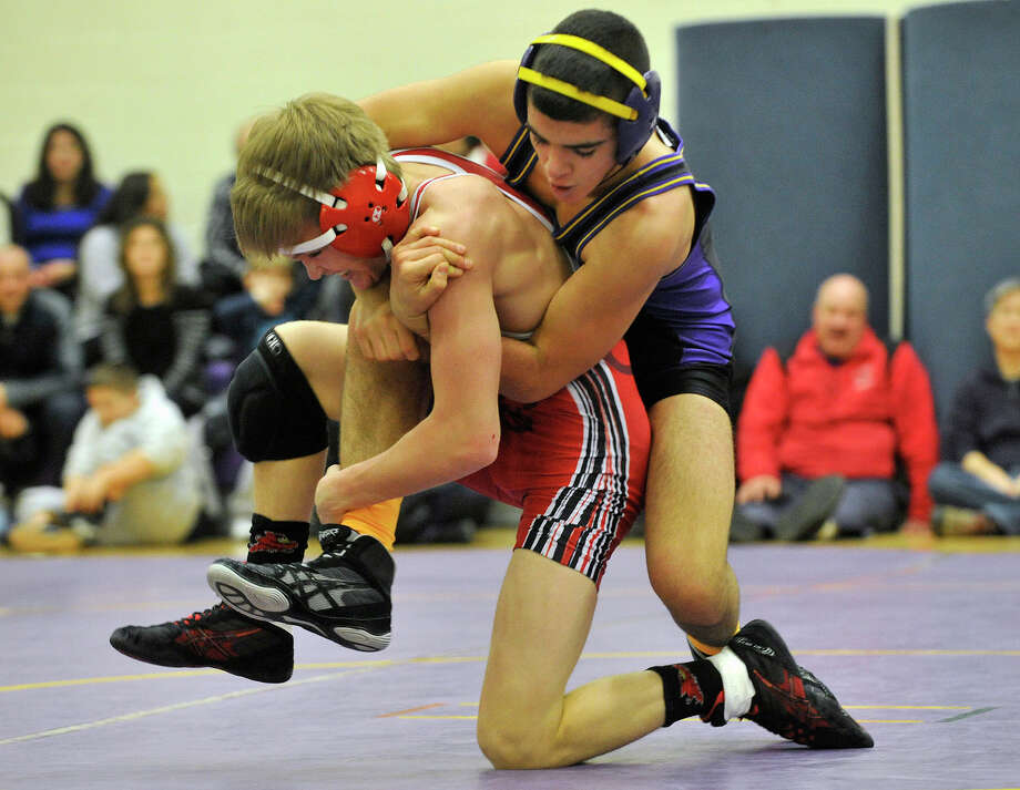 Greenwich's Jack Benenson wrestles Westhill's Matthew Conte in the 120-pound weight class during their wrestling match at Westhill High School in Stamford, Conn., on Thursday, Jan. 9, 2013. Photo: Jason Rearick / Stamford Advocate