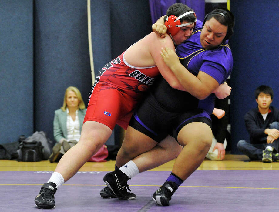 Greenwich's Christopher Fischer wrestles Westhill's Mark Cotuc in the heavyweight weight class during their wrestling match at Westhill High School in Stamford, Conn., on Thursday, Jan. 9, 2013. Photo: Jason Rearick / Stamford Advocate