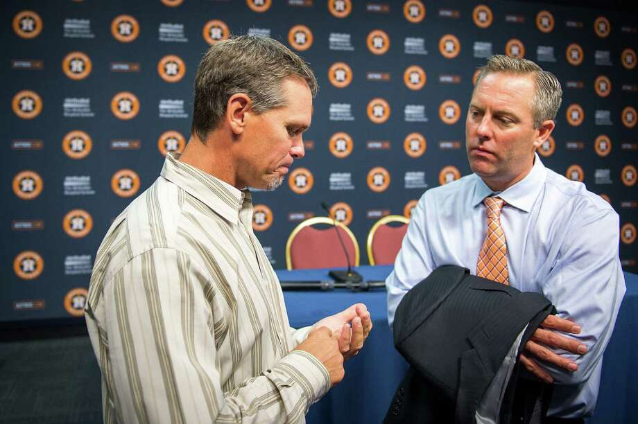 Astros president Reid Ryan, right, was prepared to launch a season-long celebration of the Hall of Fame selections of Craig Biggio and Jeff Bagwell. Photo: Smiley N. Pool / © 2013  Smiley N. Pool