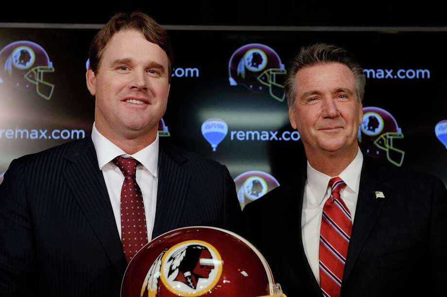 ASHBURN, VA - JANUARY 09:  Jay Gruden (L) poses for a photo with Washington Redskins Executive Vice President and General Manager Bruce Allen after he was introduced as the new head coach of the Washington Redskins during a press conference at Redskins Park on January 9, 2014 in Ashburn, Virginia.  (Photo by Patrick McDermott/Getty Images) ORG XMIT: 461930441 Photo: Patrick McDermott / 2014 Getty Images