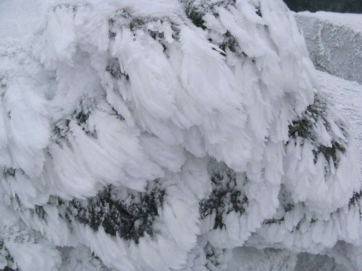 Photo by Herb Terns. Decorative ice formations on the summit cairn of Iroquois
