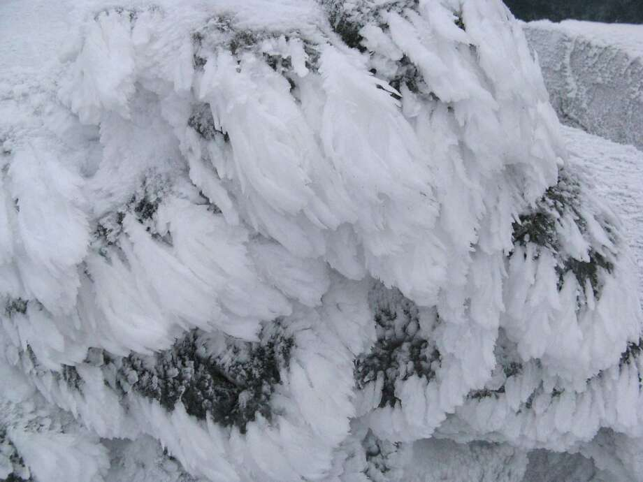 Decorative ice formations on the summit cairn of Iroquois.  Read about this hike.  Photo: Herb Terns