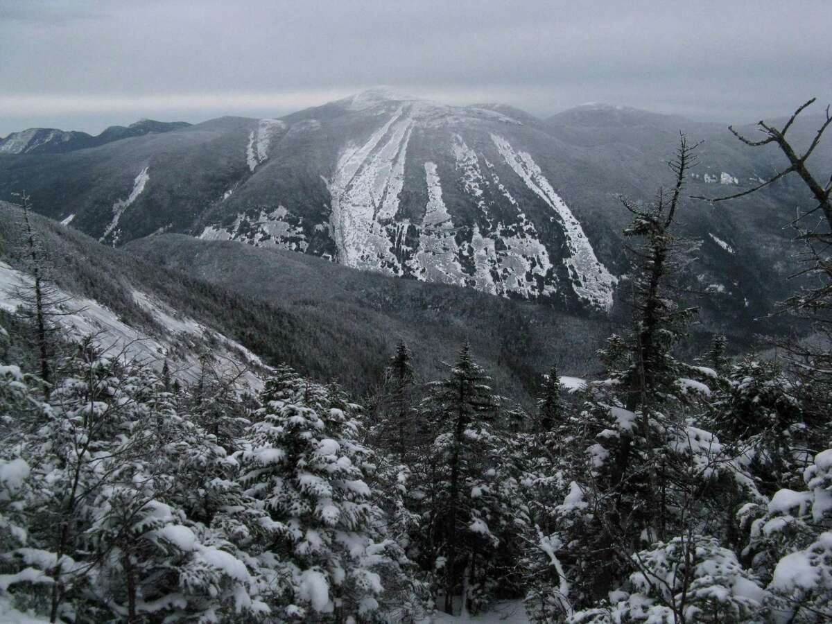 Photo by Herb Terns. Mt. Marcy behind Mt. Colden from the Algonquin Brook trail.