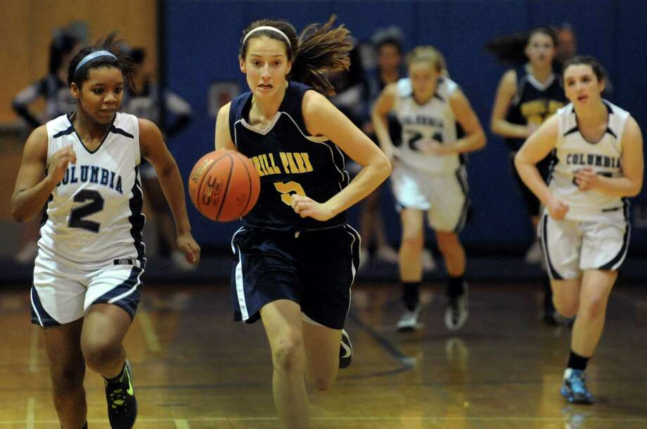 Averill Park's Kelly Donnelly (5), center, drives up court as Columbia's Nia Moore (2), left, defends during their basketball on Friday, Dec. 14, 2012, at Columbia High in East Greenbush, N.Y. (Cindy Schultz / Times Union) Photo: Cindy Schultz / 00020456A