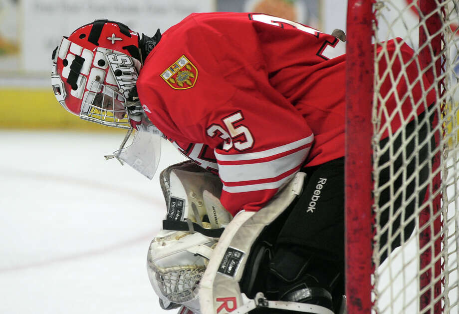 Fairfield Prep goalie Chris Gutierrez sits dejected after Notre Dame of Fairfield scored a goal, during boys hockey action at the Webster Bank Arena in Bridgeport, Conn. on Thursday January 9, 2014. Photo: Christian Abraham / Connecticut Post