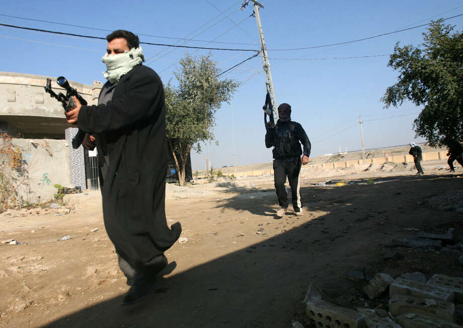 Gunmen are on alert in Fallujah, where tribal leaders have warned al-Qaida fighters there to leave to avoid a military showdown, and there are signs that residents of Fallujah are trying to restore a sense of normalcy, however precarious. Photo: Associated Press / AP