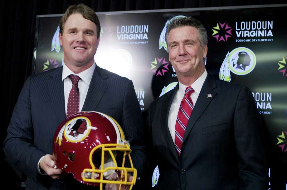 Jay Gruden (left), standing with Redskins GM Bruce Allen, will try to turn around a team that finished 3-13 last season. Photo: Manuel Balce Ceneta / Associated Press / AP