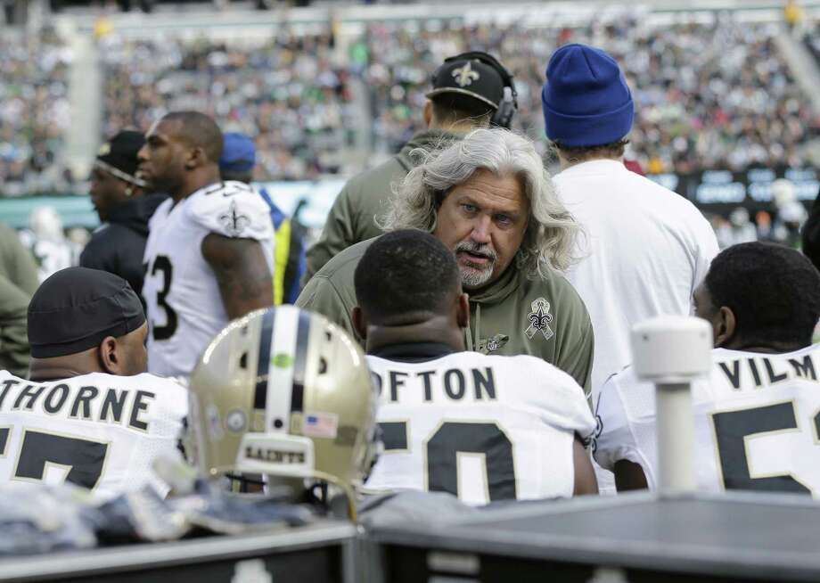 Defensive coordinator Rob Ryan (center) has had to adjust his schemes because of injuries, but the Saints keep winning. Photo: Mel Evans / Associated Press / AP