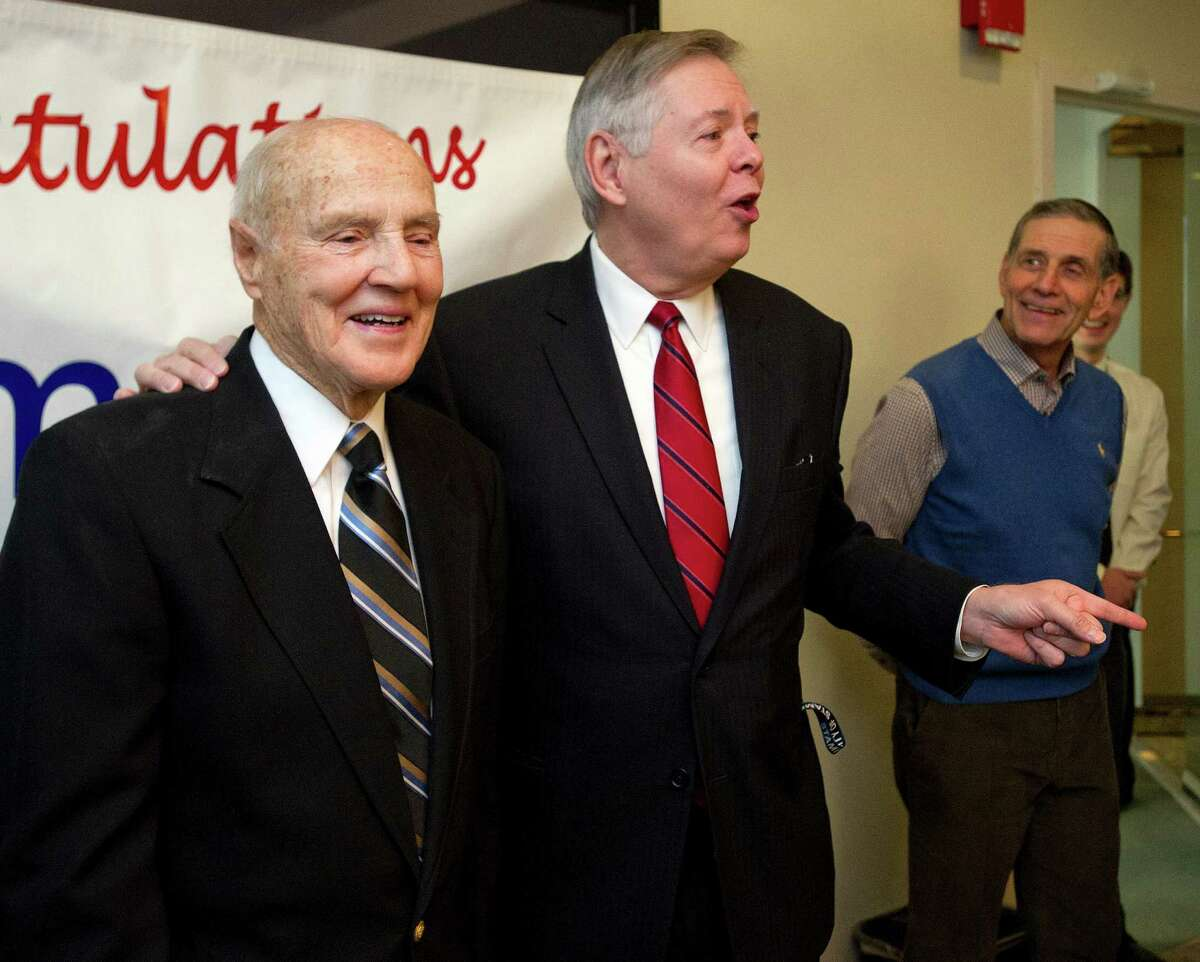 Tim Curtin, special assistant to the mayor, stands with Mayor David Martin during a surprise ceremony at which Curtin was honored as Stamford Citizen of the Year at the Government Center in Stamford on Thursday.