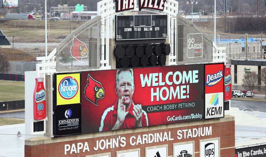 A message on the video board at Papa John's Cardinal Stadium welcomes Bobby Petrino back to Louisville. Petrino, who coached the Cardinals from 2003-06, got a seven-year contract to lead the program again. Photo: Andy Lyons / Getty Images / 2014 Getty Images