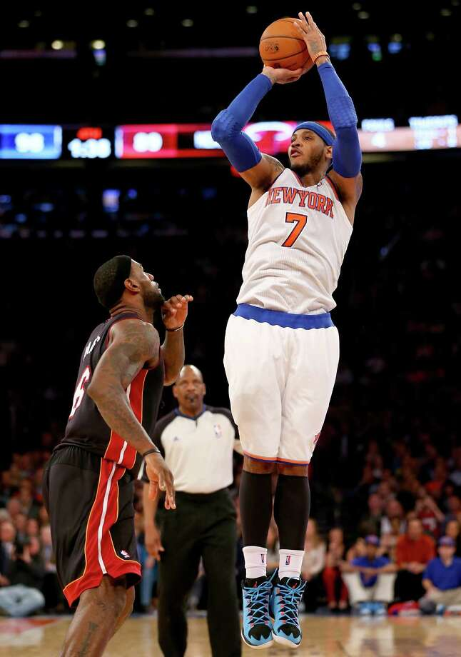 NEW YORK, NY - JANUARY 09:  Carmelo Anthony #7 of the New York Knicks shoots a three pointer over LeBron James #6 of the Miami Heat at Madison Square Garden on January 9, 2014 in New York City.The New York Knicks defeated the Miami Heat 102-92. NOTE TO USER: User expressly acknowledges and agrees that, by downloading and/or using this photograph, user is consenting to the terms and conditions of the Getty Images License Agreement.  (Photo by Elsa/Getty Images) ORG XMIT: 182412434 Photo: Elsa / 2014 Getty Images