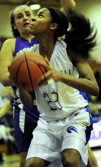 Albany's Mylah Chandler, right, aims for the hoop as Catholic Central's Caterina Giglio defends duri
