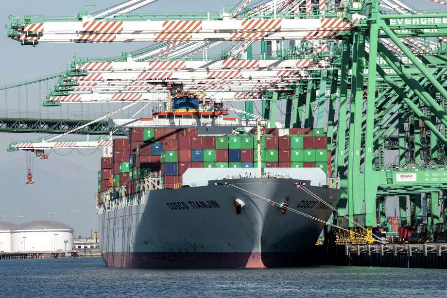 A cargo ship docks in Los Angeles this fall. Record exports and the smallest trade deficit in four years are among the factors causing economists to sharply revise their expectations for U.S. growth from late 2013 and in early 2014. Photo: MONICA ALMEIDA, STF / NYTNS