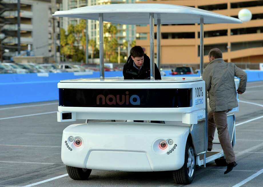Induct Technology demonstrates its laser-guided Navia driverless shuttle this week at the International CES in Las Vegas. Photo: Jack Dempsey, FRE / FR42408 AP