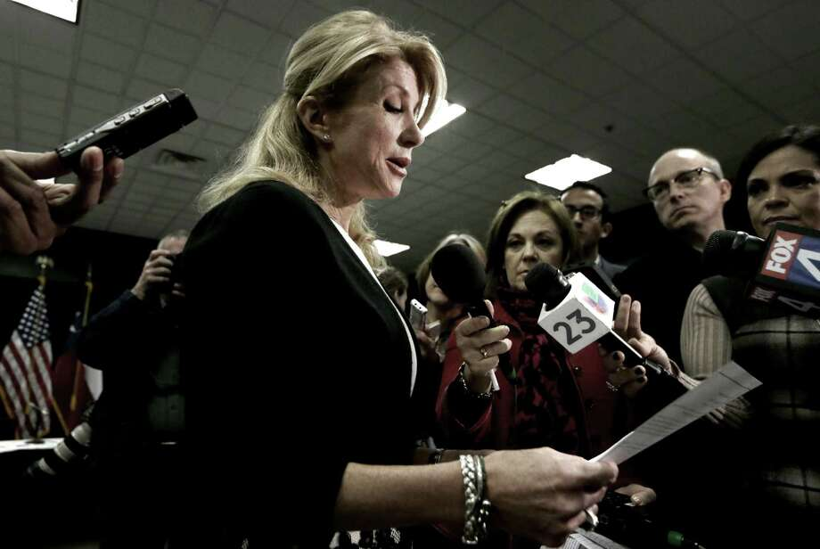 State Sen. Wendy Davis reads her education proposals to reporters after a meeting in Arlington. The Democratic gubernatorial hopeful unveiled her ideas at an education roundtable. Photo: LM Otero / Associated Press / AP