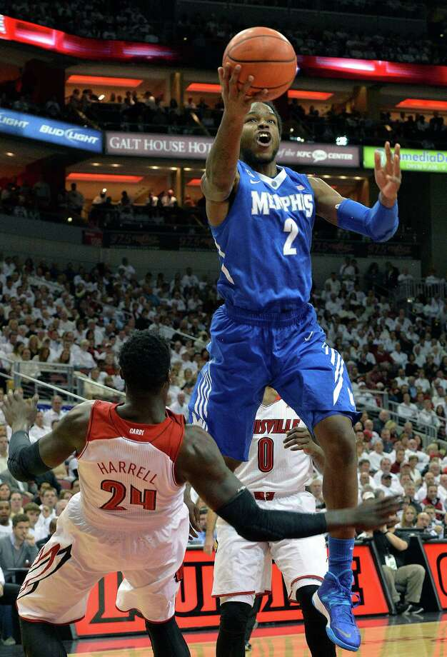 Memphis' Shaq Goodwin, right, shoots over the attempted block of Louisville's Montrezl Harrell during the first half of an NCAA college basketball game on Thursday Jan. 9, 2014, in Louisville, Ky. (AP Photo/Timothy D. Easley) ORG XMIT: KYTE117 Photo: Timothy D. Easley / FR43398 AP