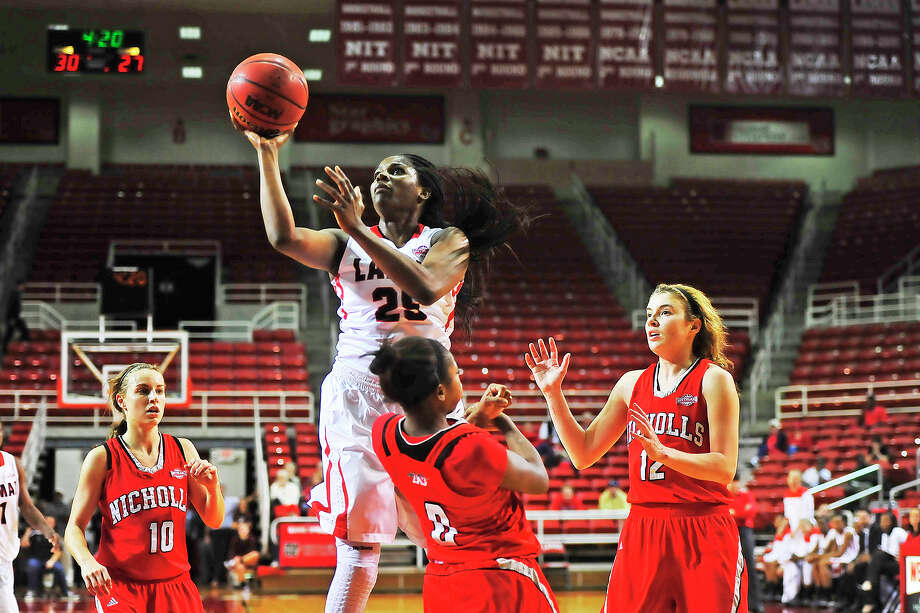 Lamar Lady Cardinals Dominique Edwards, No. 25, drives the ball in for two points during Thursday's game against Nicholls Colonels at the Montagne Center. Michael Rivera/@michaelrivera88   Photo taken Thursday, 01/09/14