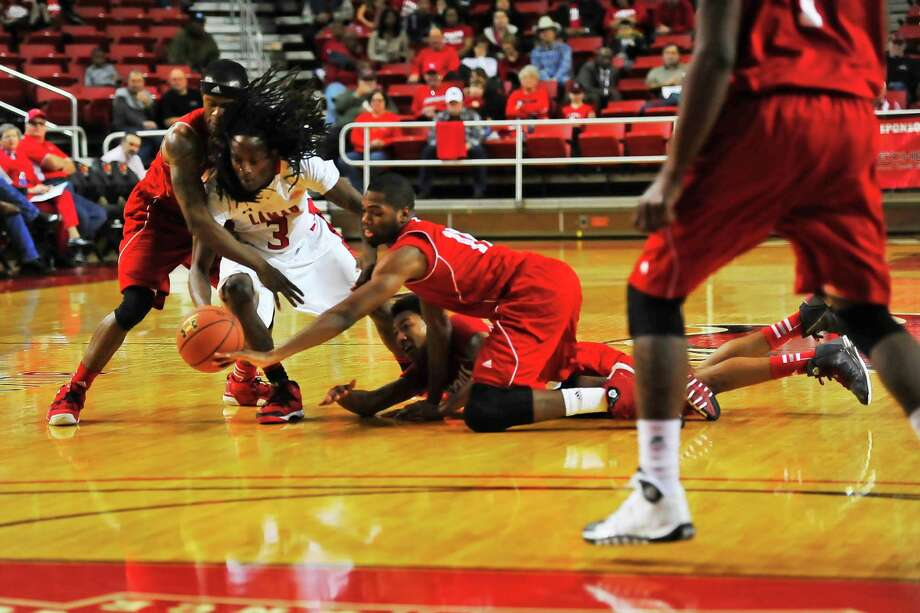 Lamar Cardinals Donnell Minton, No. 3 , dives for possession of the ball during Thursday's game against Nicholls Colonels at the Montagne Center. Michael Rivera/@michaelrivera88   Photo taken Thursday, 01/09/14