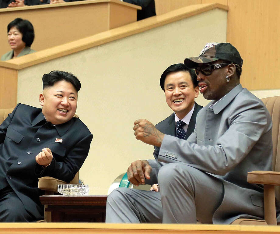 North Korean leader Kim Jong Un (left) and Dennis Rodman watch the game between former NBA players and North Korean players. Photo: Korean Central News Agency / Getty Images / AFP