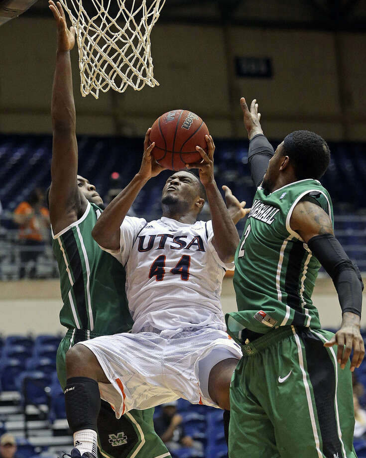 UTSA guard Keon Lewis (center) shoots between two Marshall defenders in the Conference USA opener for both teams. Lewis came off the bench to lead the Roadrunners with 23 points. Photo: Tom Reel / San Antonio Express-News