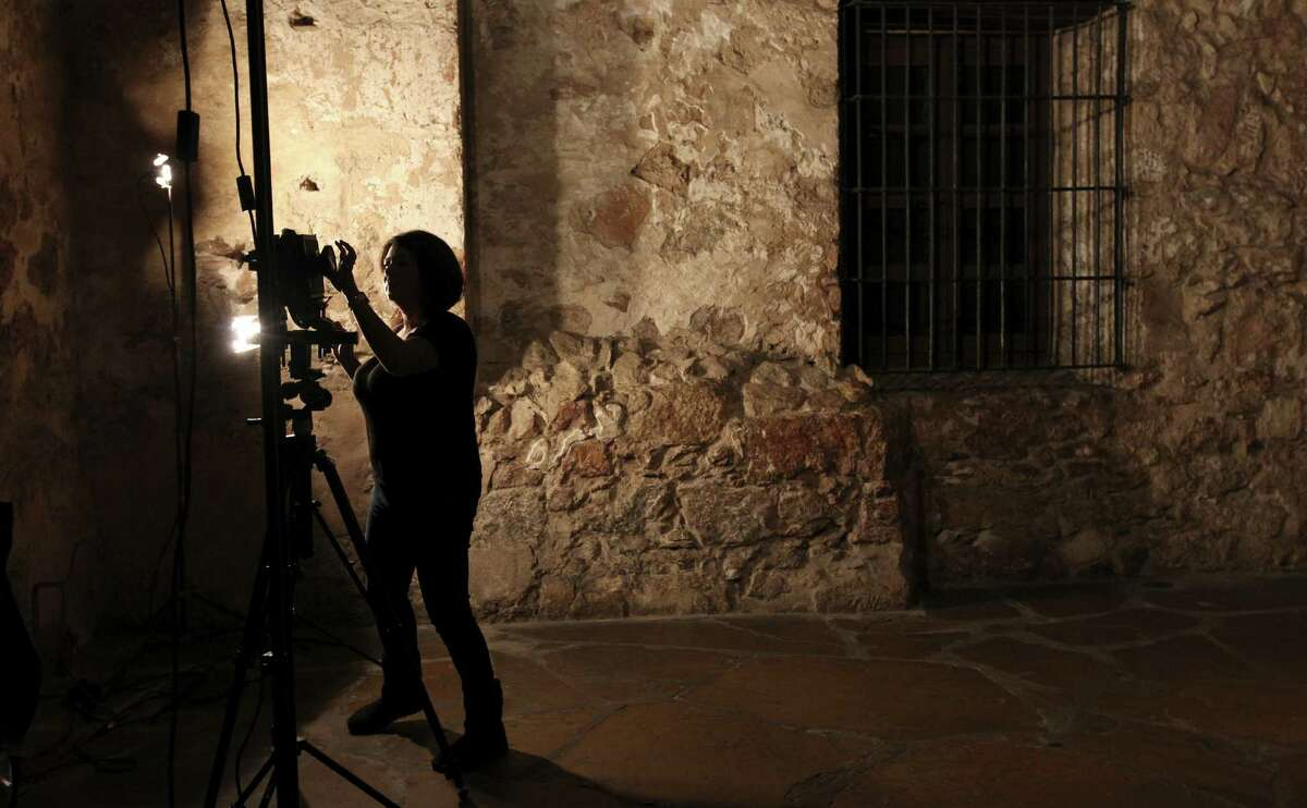 Texas A&M Kingsville graduate student civil engineering major Anna Leija, 28, prepares to photograph a section of the Alamo.