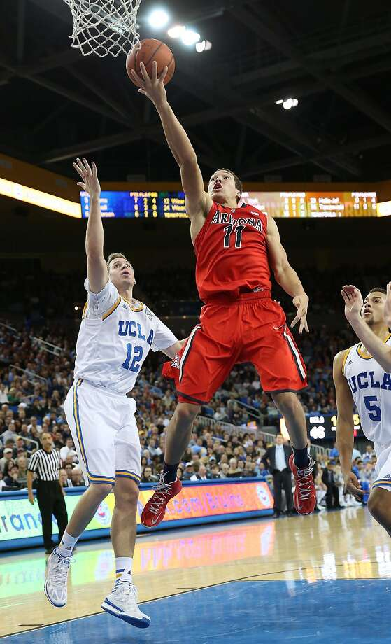 Aaron Gordon, from Mitty High School, shoots over UCLA's David Wear in Arizona's win at Pauley Pavilion. Photo: Stephen Dunn, Getty Images