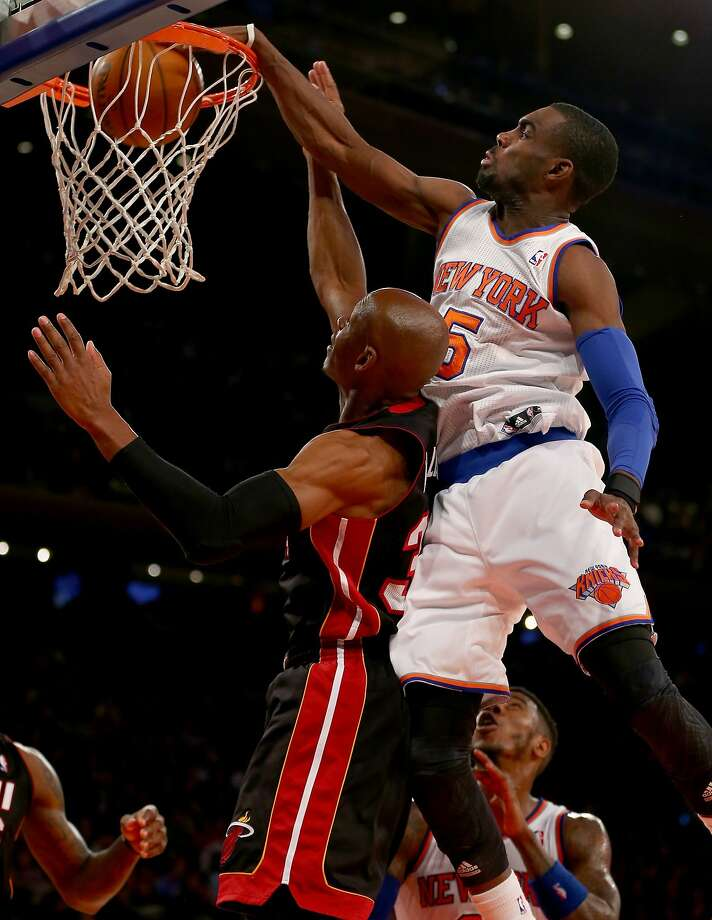 Tim Hardaway Jr. dunks on Ray Allen as the Knicks win their fourth out of five games in 2014. Photo: Elsa, Getty Images