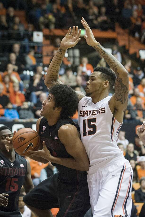 Stanford's Josh Huestis (left) tries to get around Oregon State's Eric Moreland during the first half. Photo: Karl Maasdam, Associated Press