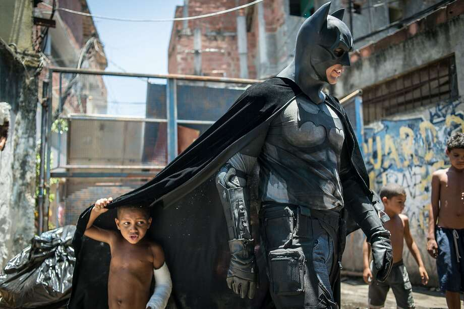 Can the Caped Crusader save the slum?Batman lends his support to kids of Rio's Favela do Metro slum, which has been designated for demolition in an effort to clean up the neighborhoods around Maracana stadium before the World Cup. Many families are refusing to leave their shantytown homes. Photo: Yasuyoshi Chiba, AFP/Getty Images